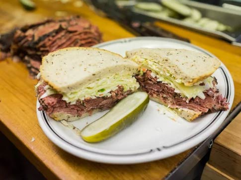 Pastrami sandwich with pickles