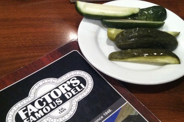 Pickles on a plate closeup, menu on the table