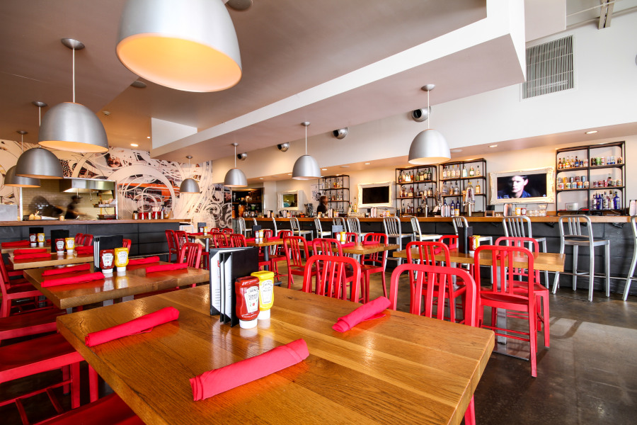 interior, red napkins and chairs, wooden tables