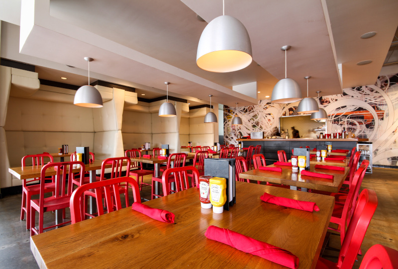interior, red napkins, white chandeliers