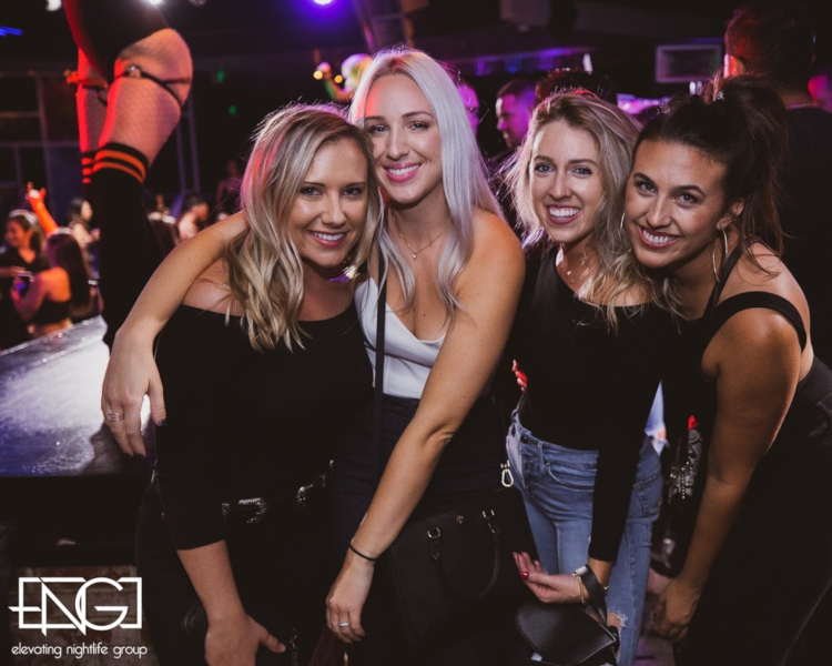 A group of girls on a night out posing for a photo