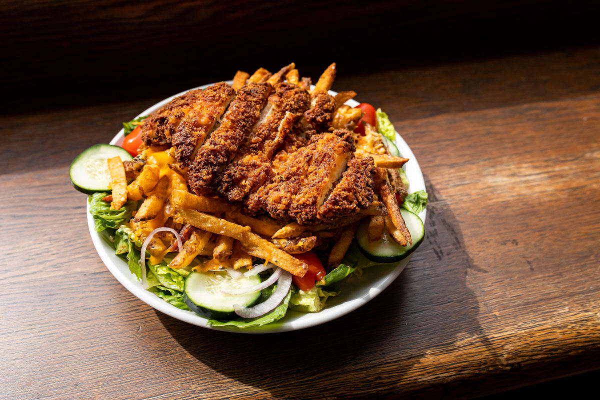 Grilled meat, fries and salad
