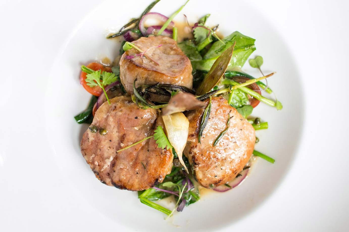 photo of pork chops with vegetable meal