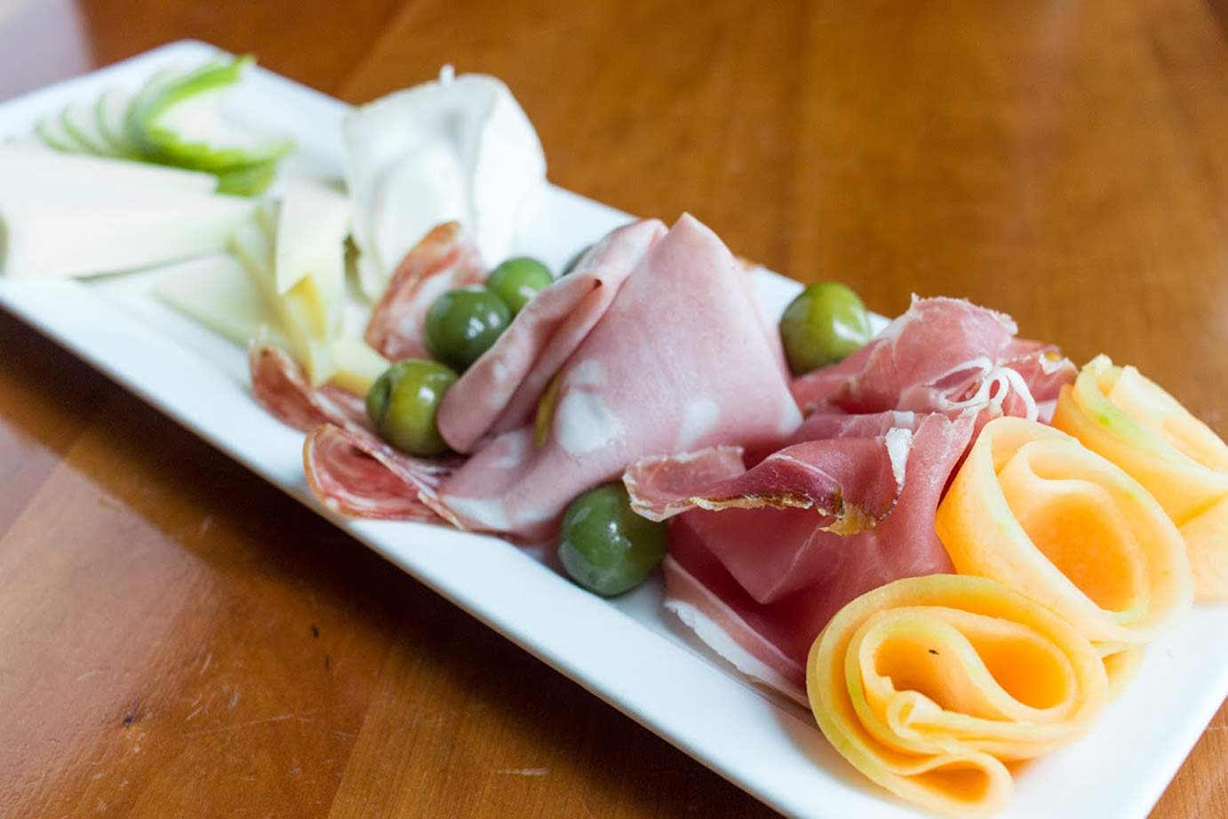 photo of smoked ham with cheese and olives