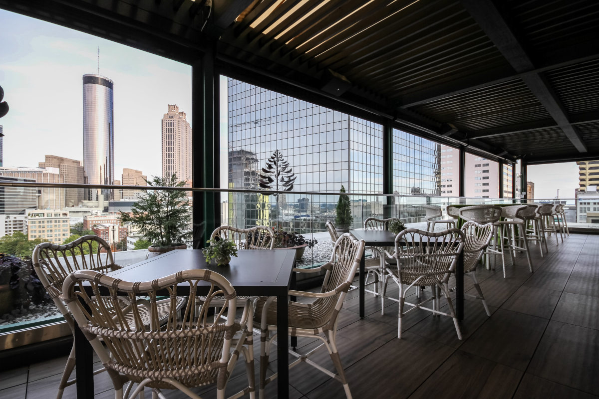 Outdoor patio, sitting tables with city view