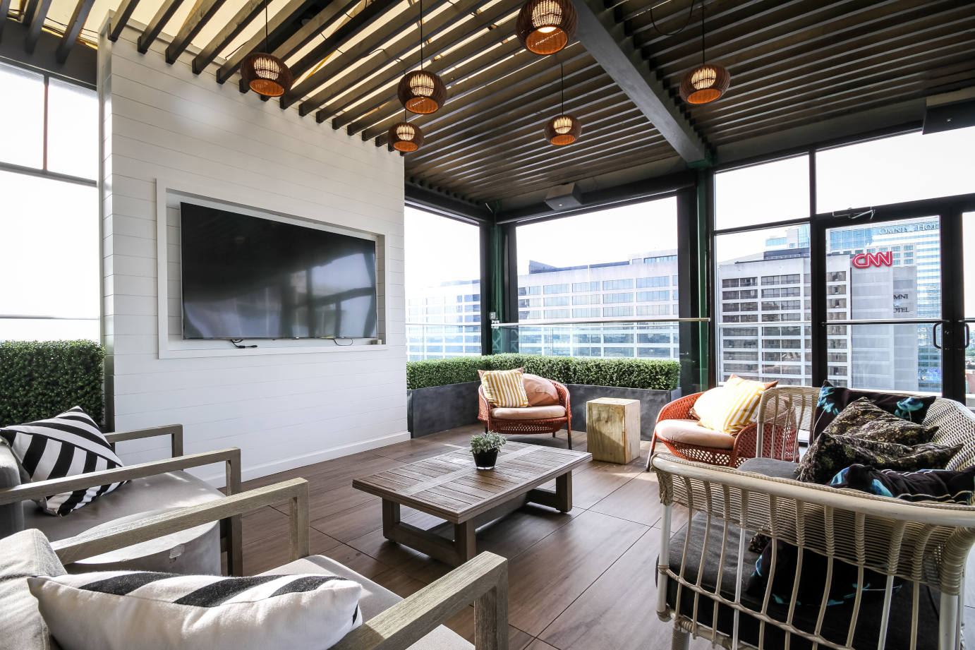 Outdoor patio, sitting table with big tv