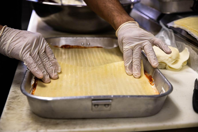 Chef preparing lasagna