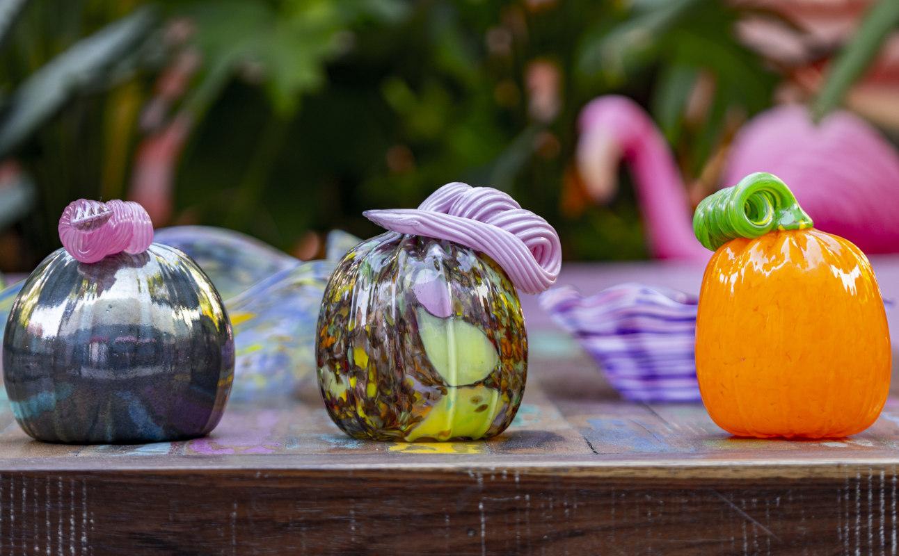 three glass pumpkins