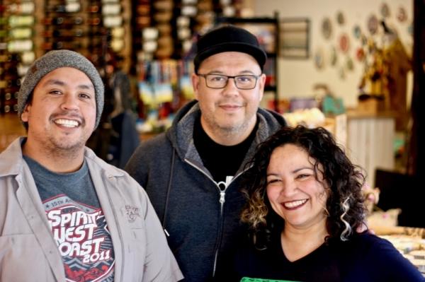 Jesse Gallegos, John Avila and Veronica Avila posing for a photo