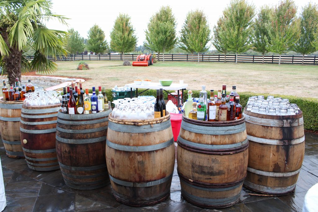 Barrels with various drinks and glasses on them