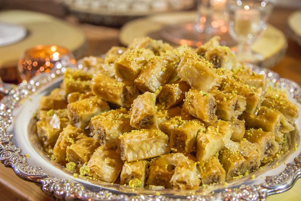A big plate of baklava pieces