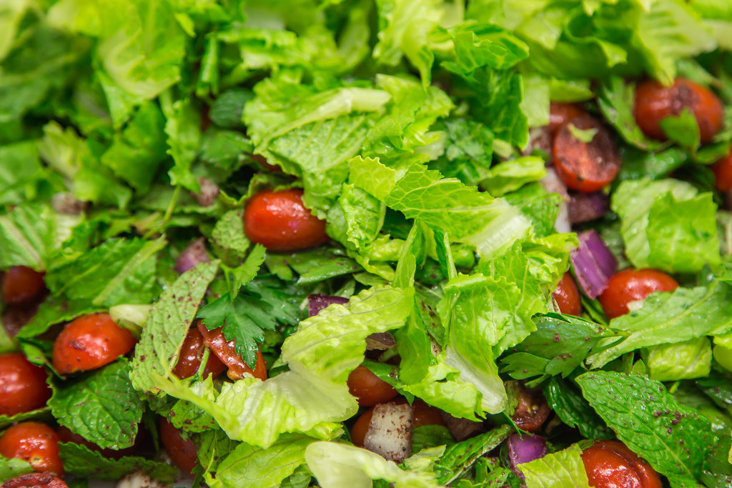 Green salad with cherry tomatoes, extreme closeup