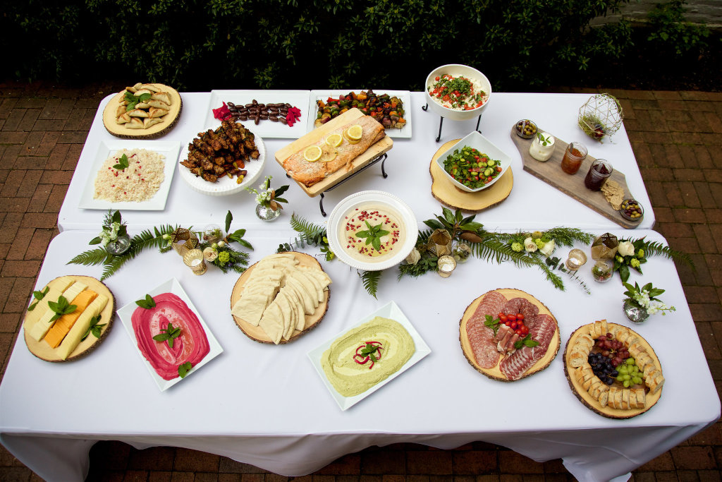 A table with dips, spreads and finger food