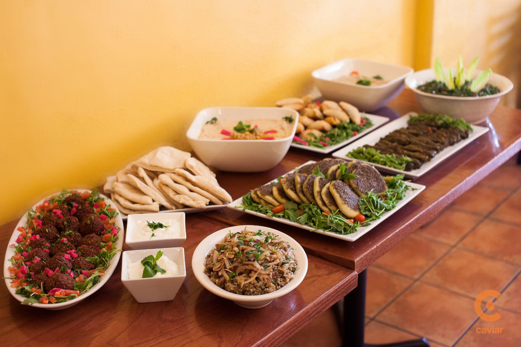 Catering tables by the wall, a large variety of dishes