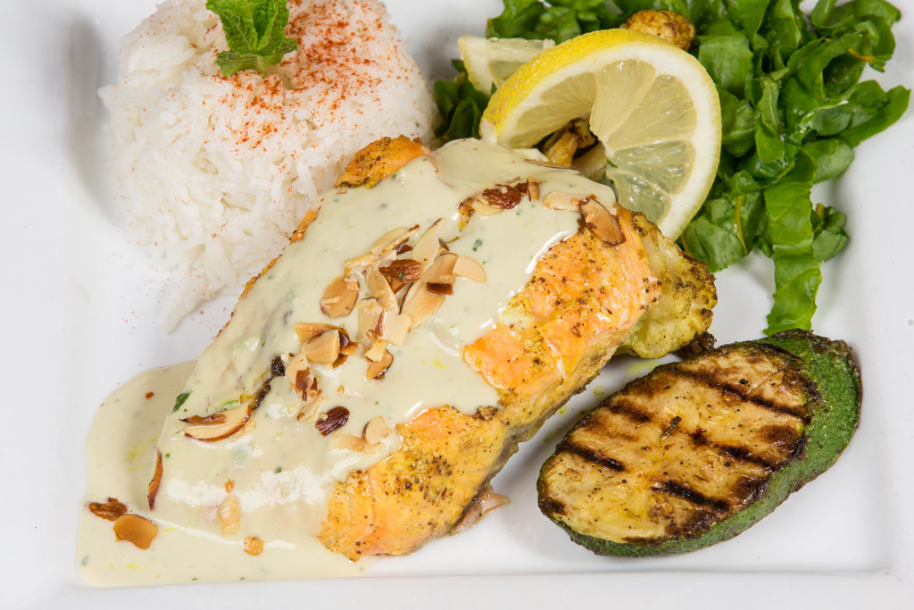 Grilled veggies with greens, rice and white sauce with nuts
