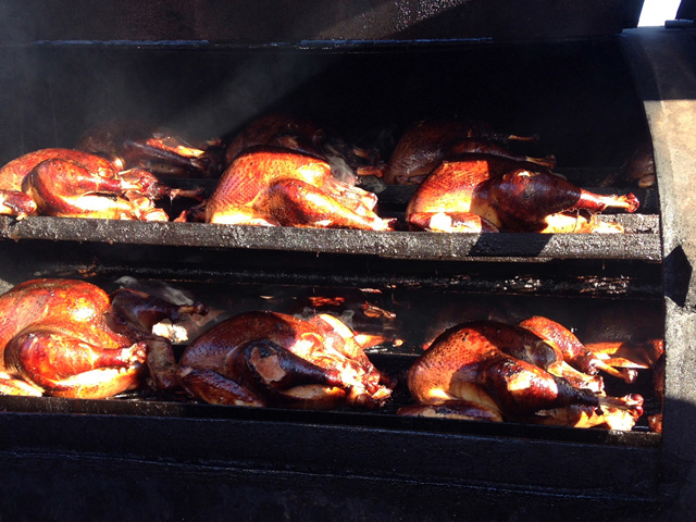 Two rows of turkeys on the grill