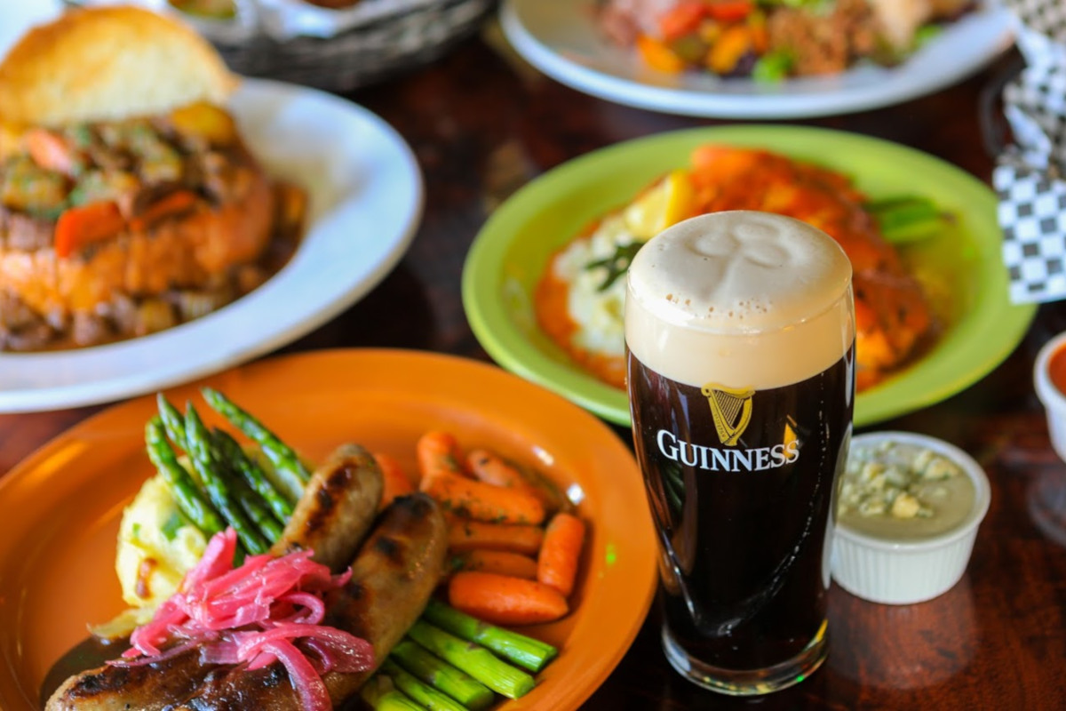 Different types of food and glass of beer