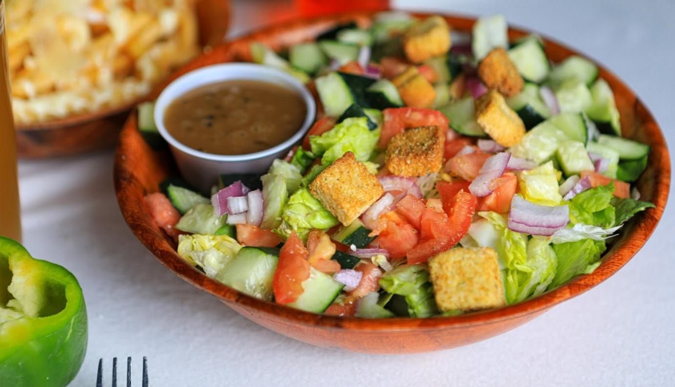 Mixed salad and dip on the side
