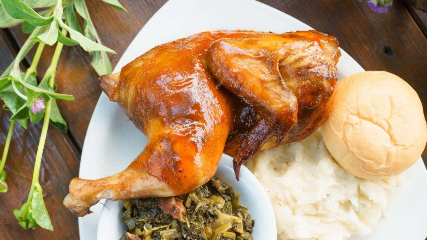 Smoked Half Chicken With Southern-style turnip greens and mashed potatoes