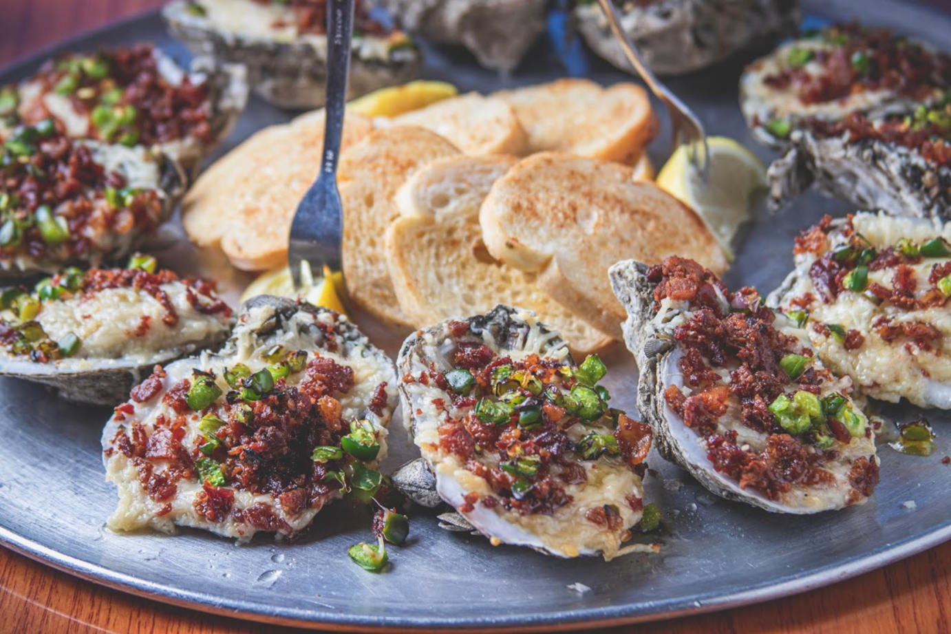 Oysters on the Half Shell topped with parmesan cheese, bacon, and jalapenos