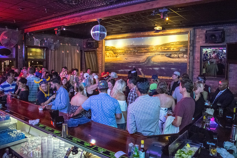 Interior, bar area, guests having fun