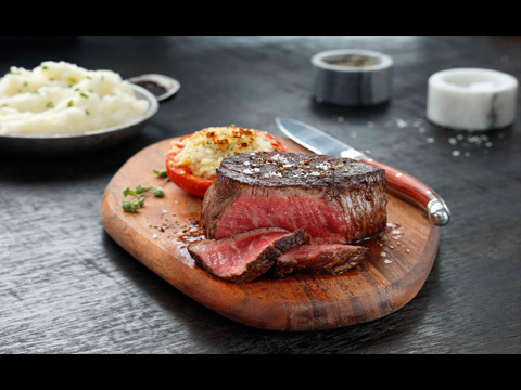 juicy steak on a wooden board