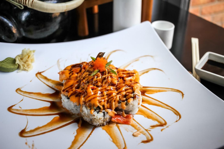Rice, sea food, orange sauce on top