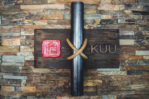 KUU sign on the wall with a pipe