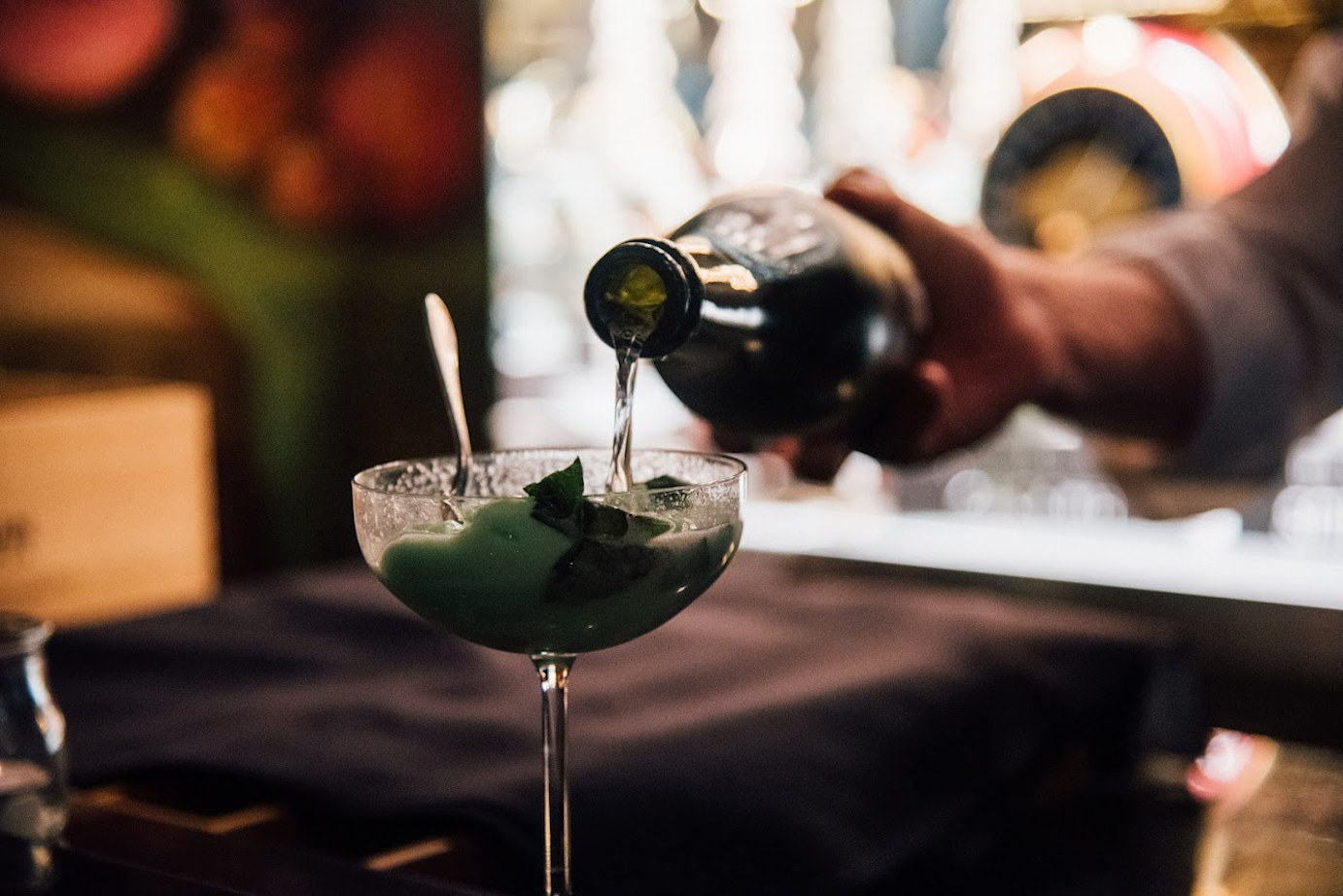 Staff member making a cocktail