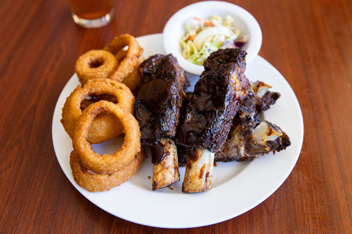 Grilled meat, onion rings on the side