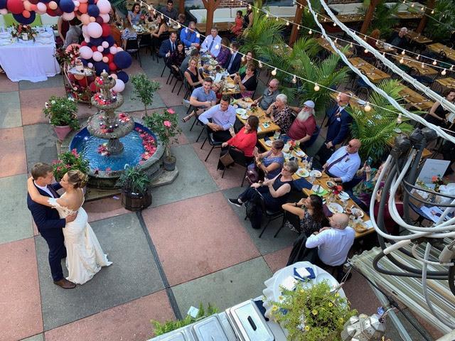 Exterior, bride and groom dancing