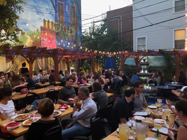 Exterior, big tables, lots of guests
