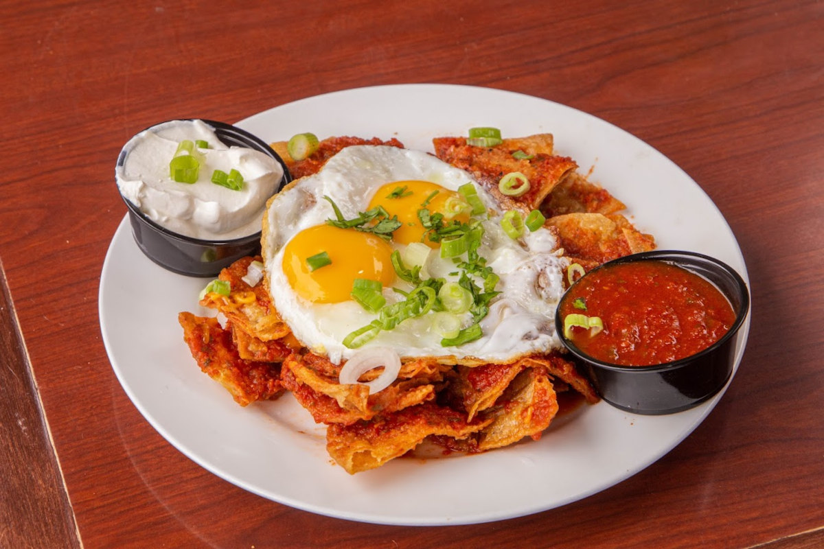 Snacks, fried eggs and two dips on the side