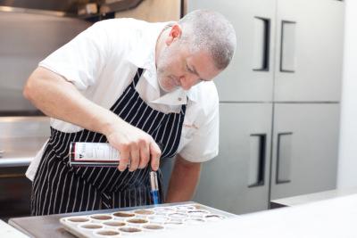 Chef searing desserts
