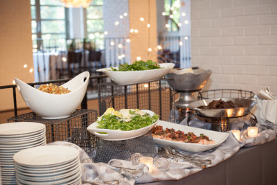 Catering table with meat and salads