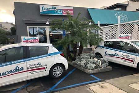 delivery cars in front of the Point Loma Leucadia Pizzeria