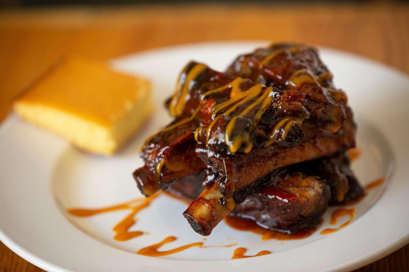 Slow smoked ribs with herbs and spices with sauces
