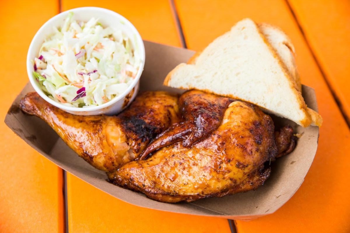 Grilled chicken, bread, salad on the sideRestaurant interior