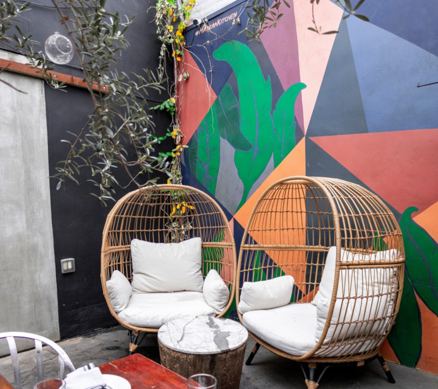 Patio seating area by a mural