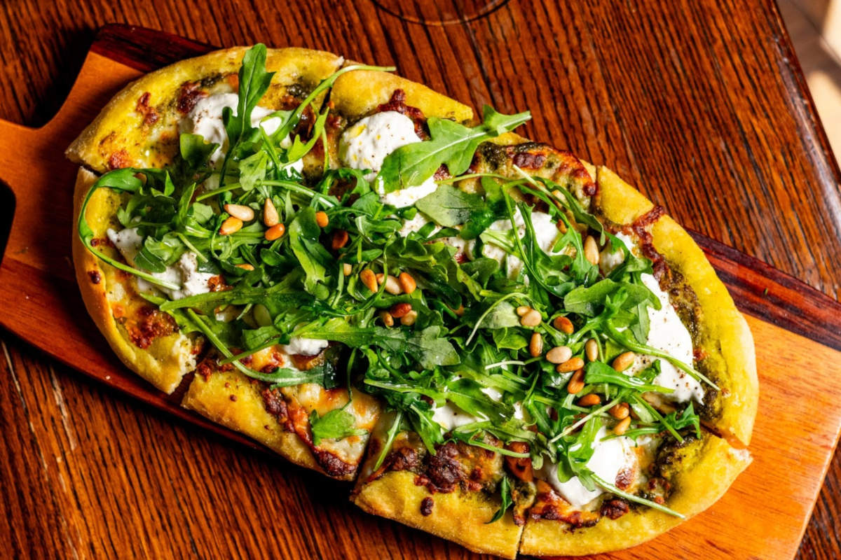 Flat bread with cheese and arugula