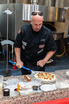 Tore Trupiano tops his five grain crust with mozzarella, nduja sausage and cipollini onions.