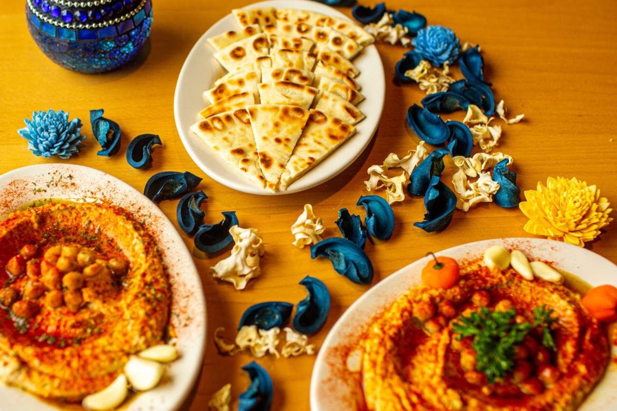 Marinated chicken kabob served with Turkish rice, hummus, salad, pita bread
