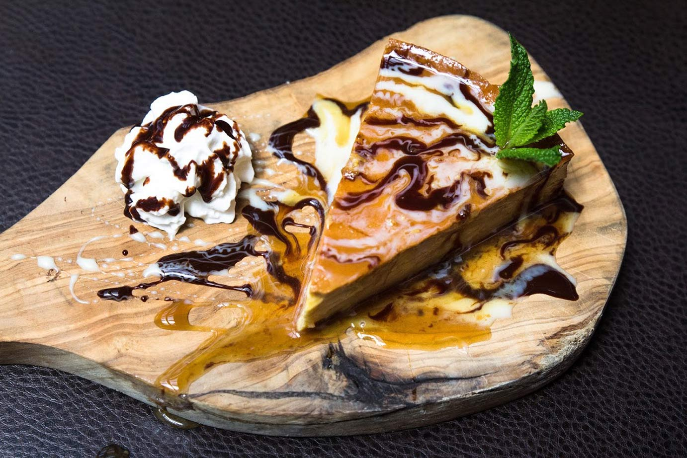photo of cheesecake with syrup