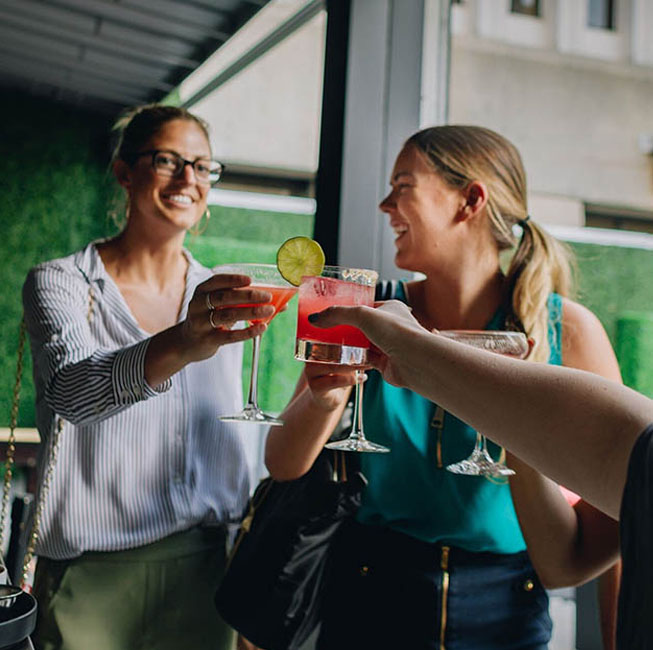 Guests drinking cocktails, having fun