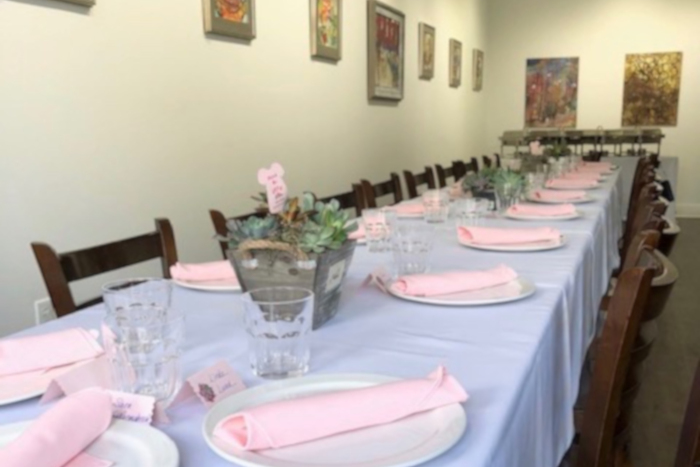 Long table room with paintings on the walls