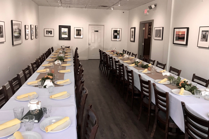 Dining room for large groups, framed pictures on the walls