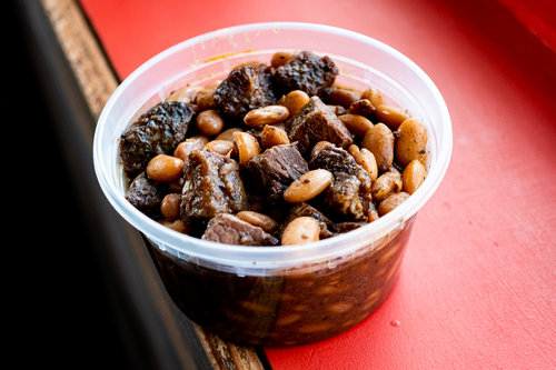 Grilled sliced meat with beans
