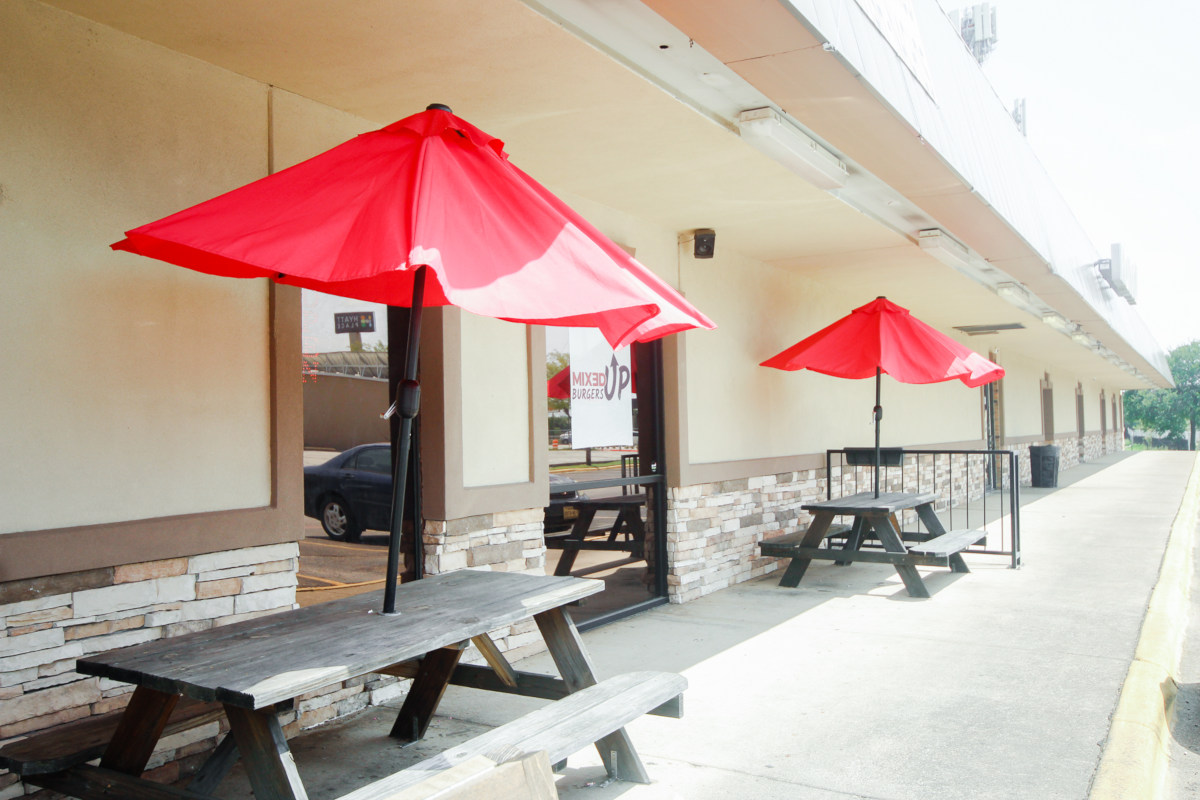 Exterior seating area with red parasols