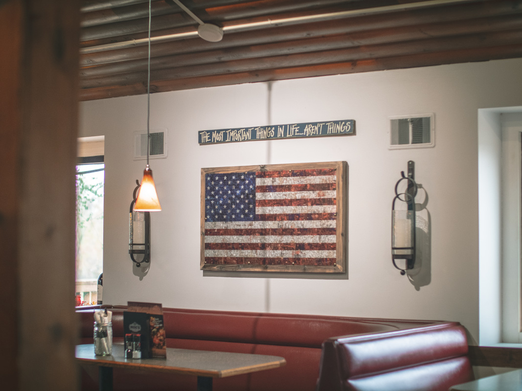 American flag with a message above