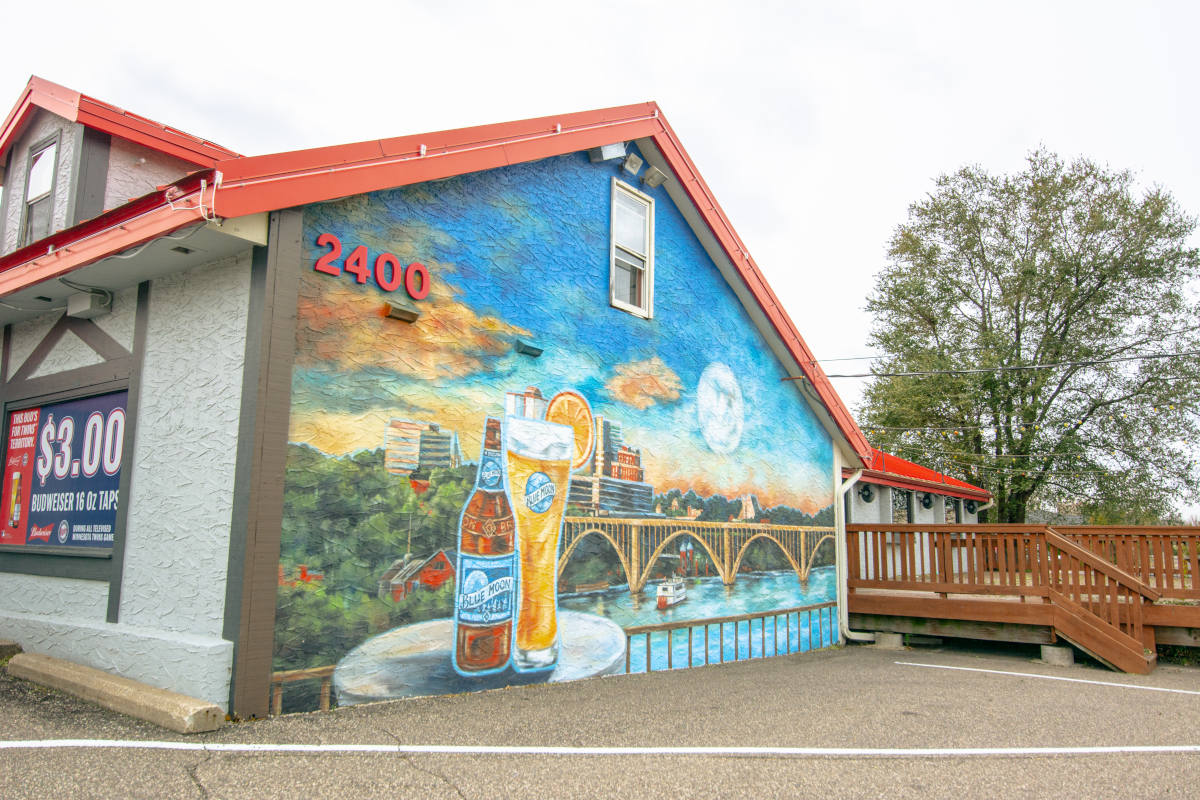 exterior, back of the restaurant, wall painting of city scenery